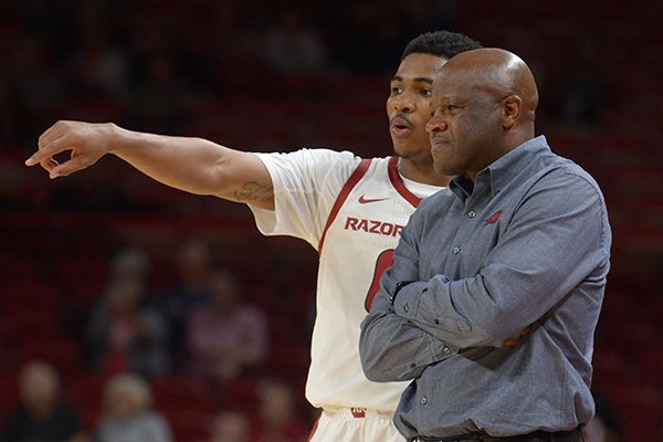 Arkansas coach Mike Anderson speaks to guard Desi Sills against Southwest Baptist Friday, Nov. 2, 2018, during the second half of their exhibition game in Bud Walton Arena. Visit nwadg.com/photos to see more photographs from the game.