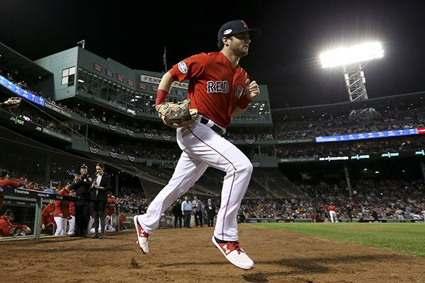 Boston Red Sox center fielder Jackie Bradley Jr., left, and left fielder Andrew Benintendi take the field for the first inning of Game 2 of a baseball American League Division Series against the New York Yankees, Saturday, Oct. 6, 2018, in Boston. (AP Photo/Elise Amendola)