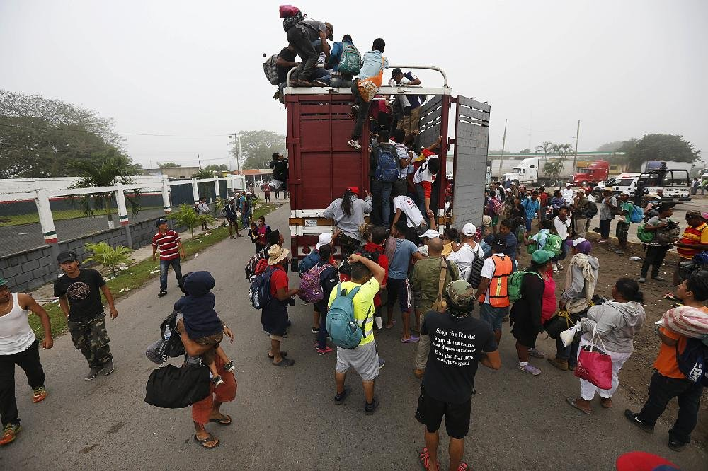 Migrants from Central America pack into the back of a trailer truck Sunday in Isla, Mexico, as they begin their morning journey hop- ing to reach the U.S. border.