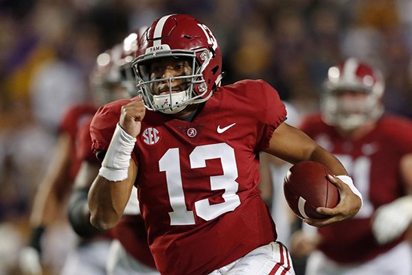 Alabama quarterback Tua Tagovailoa (13) rushes on a 44 yard touchdown carry in the second half of an NCAA college football game in Baton Rouge, La., Saturday, Nov. 3, 2018. Alabama won 29-0. (AP Photo/Gerald Herbert)