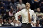 Texas head coach Shaka Smart calls out from the bench in the second half of a first-round game against Nevada in the NCAA college basketball tournament in Nashville, Tenn., Friday, March 16, 2018. (AP Photo/Mark Humphrey)