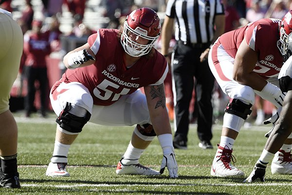 Arkansas offensive linemen Hjalte Froholdt gets ready to run a play against Vanderbilt in the first half of an NCAA college football game Saturday, Oct. 27, 2018, in Fayetteville, Ark. (AP Photo/Michael Woods)