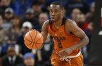 Texas' Matt Coleman during an NCAA college basketball game during the Phil Knight Invitational tournament in Portland, Ore., Thursday, Nov. 23, 2017. (AP Photo/Timothy J. Gonzalez)