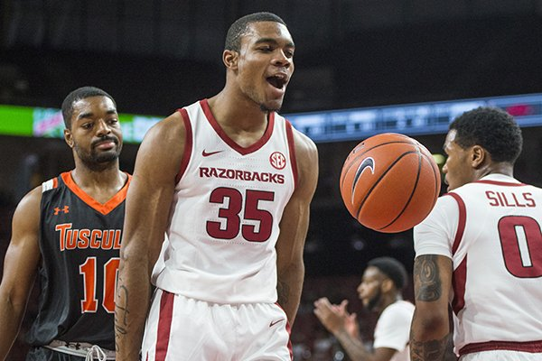 Reggie Chaney of Arkansas reacts after a basket in the first half vs Tusculum Friday, Oct. 26, 2018, during an exhibition game in Bud Walton Arena in Fayetteville.