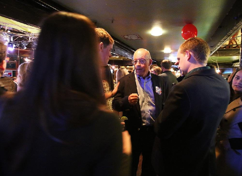 Little Rock mayoral candidate Baker Kurrus greets supporters Tuesday evening at his election party at Cajun's Wharf in Little Rock.
