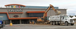 The Sentinel-Record/Richard Rasmussen UNDER CONSTRUCTION: A backhoe dumps a load of dirt into a truck Wednesday in the parking lot at Oaklawn Racing and Gaming as part of improvement projects that have been taking place since this summer.
