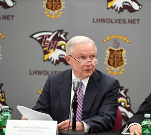 The Sentinel-Record/File photo OUT THE DOOR: U.S. Attorney General Jeff Sessions, who visited Lake Hamilton School District in early August for a roundtable discussion on school safety, submitted his resignation at President Donald Trump's request Wednesday. Trump later announced Sessions' chief of staff, Matthew Whitaker, would assume the role of acting attorney general.