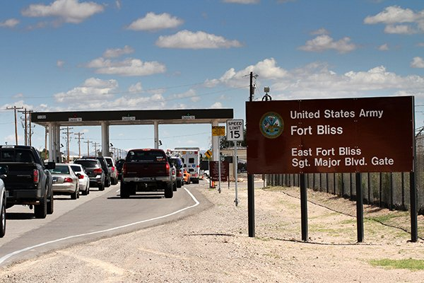 This Sept. 9, 2014 file photo shows cars wait to enter Fort Bliss in El Paso, Texas. (AP Photo/Juan Carlos Llorca)
