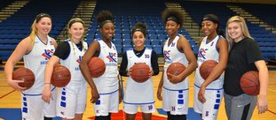 Former Magnolia Lady Panthers Kisi Young (third from left) and Lillie Moore (second from right) are again playing major roles for the Kansas City Kansas Community College Lady Blue Devils. After three wins to start the season, Moore is averages 17.0 points per outing and Young 15.2 points.