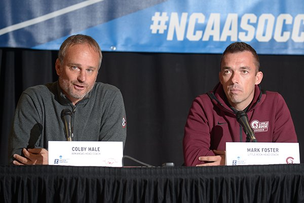 Arkansas soccer coach Colby Hale (left) speaks Thursday, Nov. 8, 2018, alongside Little Rock soccer coach Mark Foster during a press conference in Bud Walton Arena ahead of today's NCAA Women's Soccer Tournament first-round game.