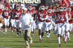 Arkansas coach Chad Morris runs onto the field before playing Vanderbilt in an NCAA college football game Saturday, Oct. 27, 2018, in Fayetteville, Ark. (AP Photo/Michael Woods)