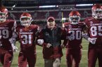 Arkansas coach Chad Morris and players walk arm-in-arm down the field prior to a game against LSU on Saturday, Nov. 10, 2018, in Fayetteville.