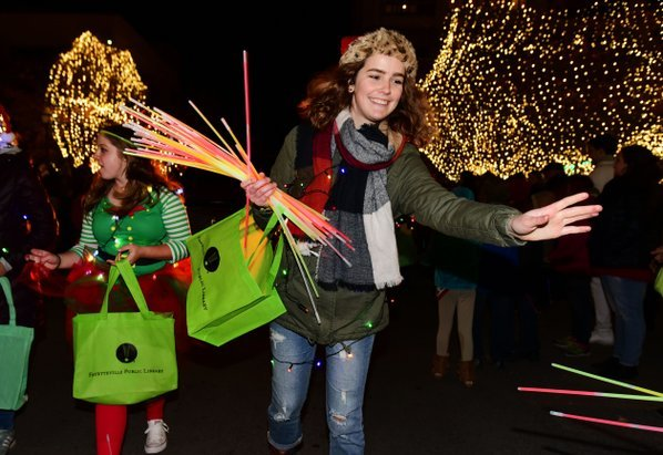 file photodavid gottschalk sarah howard tosses glow sticks during a previous lights of the ozarks parade on the square in fayetteville