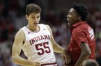 Indiana's Evan Fitzner (55) celebrates with De'Ron Davis during the first half of the team's NCAA college basketball game against Marquette, Wednesday, Nov. 14, 2018, in Bloomington, Ind. (AP Photo/Darron Cummings)