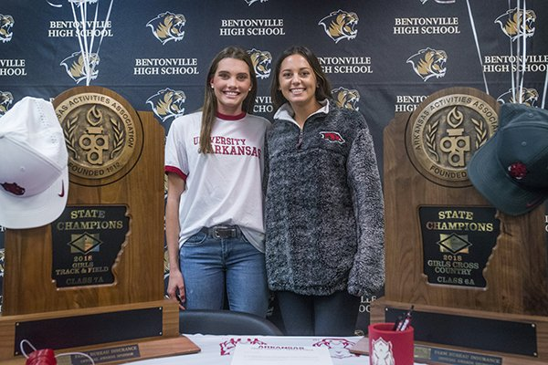 Lainey Quandt (left) and Tori Willis, Bentonville cross country runners, pose for a photo after signing to run at Arkansas on Wednesday, Nov. 14, 2018, during a signing ceremony at Bentonville's Tiger Athletic Complex.
