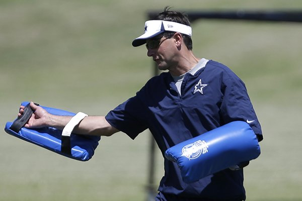 Derek Dooley, an assistant for the Dallas Cowboys instructs players during an NFL football minicamp on Tuesday, June 11, 2013, in Irving, Texas. (AP Photo/Tony Gutierrez)