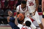 NWA Democrat-Gazette/J.T. WAMPLER Arkansas' Keyshawn Embery-Simpson (11) and Desi Sills struggle for the ball with UC Davis' T.J. Shorts II Monday Nov. 12, 2018 at Bud Walton Arena in Fayetteville.
