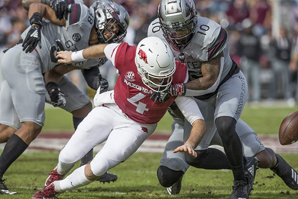 Mississippi State linebacker Leo Lewis (10) forces Arkansas quarterback Ty Storey to fumble during the second quarter Saturday, Nov. 17, 2018, at Davis Wade Stadium in Starkville, Miss. The ball was recovered first by Mississippi State, then fumbled again with Arkansas recovering for a first down.
