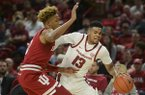 Arkansas guard Mason Jones (13) dribbles past Indiana guard Romeo Langford (0) during a basketball game Sunday, Nov. 18, 2018, at Bud Walton Arena in Fayetteville.