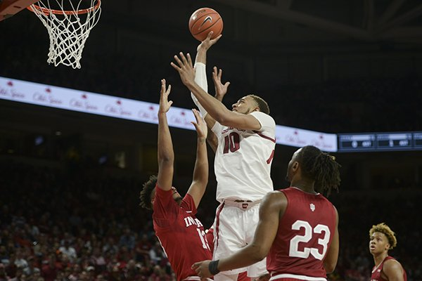 Arkansas' Daniel Gafford (10) goes up for a shot against Indiana defenders during a game Sunday, Nov. 18, 2018, in Fayetteville.