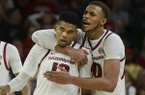 Arkansas basketball players Mason Jones (left) and Daniel Gafford embrace during a game against Indiana on Sunday, Nov. 18, 2018, in Fayetteville.
