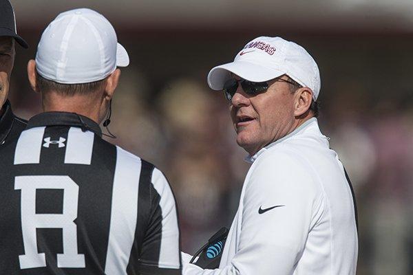 Chad Morris, Arkansas head coach, talks to officials in the second quarter vs Mississippi State Saturday, Nov. 17, 2018, at Davis Wade Stadium in Starkville, Miss.