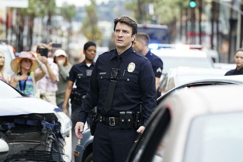 Nathan Fillion stars as John Nolan, a 40-year-old Los Angeles Police Dept. trainee in The Rookie. The series, which has a racially diverse cast, ...