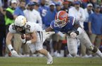Missouri wide receiver Barrett Banister (30) is tackled by Florida linebacker David Reese II (33) after catching a pass during the second half of an NCAA college football game Saturday, Nov. 3, 2018, in Gainesville, Fla. Missouri won 38-17. (AP Photo/Phelan M. Ebenhack)