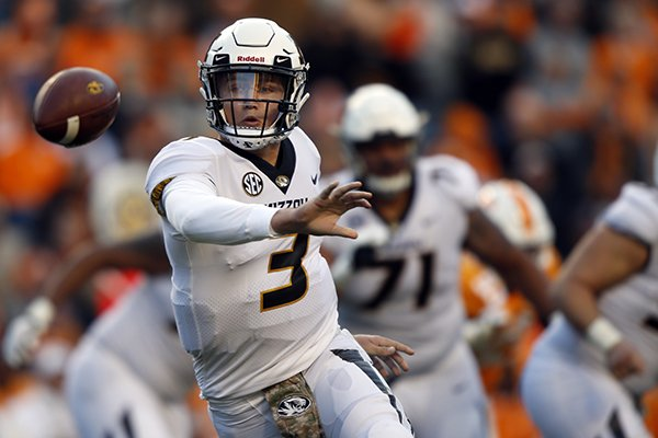 Missouri quarterback Drew Lock (3) pitches the ball in the first half of an NCAA college football game against Tennessee Saturday, Nov. 17, 2018, in Knoxville, Tenn. (AP Photo/Wade Payne)