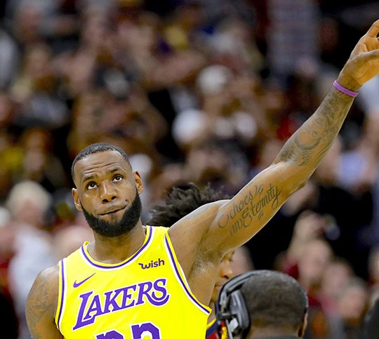 size 40 bd475 a4306 Los Angeles Lakers  LeBron James acknowledges the Cleveland fans during a  video tribute to James in the first half of an NBA basketball game between  the ...