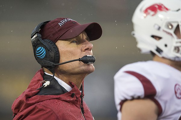Arkansas coach Chad Morris watches during the first half of a game against Missouri on Friday, Nov. 23, 2018, in Columbia, Mo.