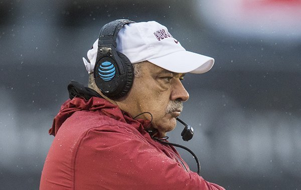 Arkansas defensive coordinator John Chavis watches during a game against Missouri on Friday, Nov. 23, 2018, in Columbia, Mo.