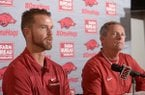 Newly hired Arkansas pitching coach Matt Hobbs (left) speaks Wednesday, Nov. 28, 2018, alongside coach Dave Van Horn during a press conference to announce his hire at Baum Stadium in Fayetteville.