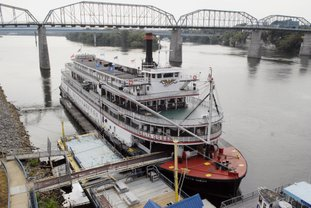 FILE - In this Sept. 25, 2013, file photo, the Delta Queen riverboat is moored at Coolidge Park on in downtown Chattanooga, Tenn. The U.S. House on Tuesday, Nov. 218, 2018, approved a bill that will allow the Delta Queen to cruise the nation's rivers once again after a 10-year layoff. President Donald Trump must still sign the bill. (John Rawlston/Chattanooga Times Free Press via AP, File)