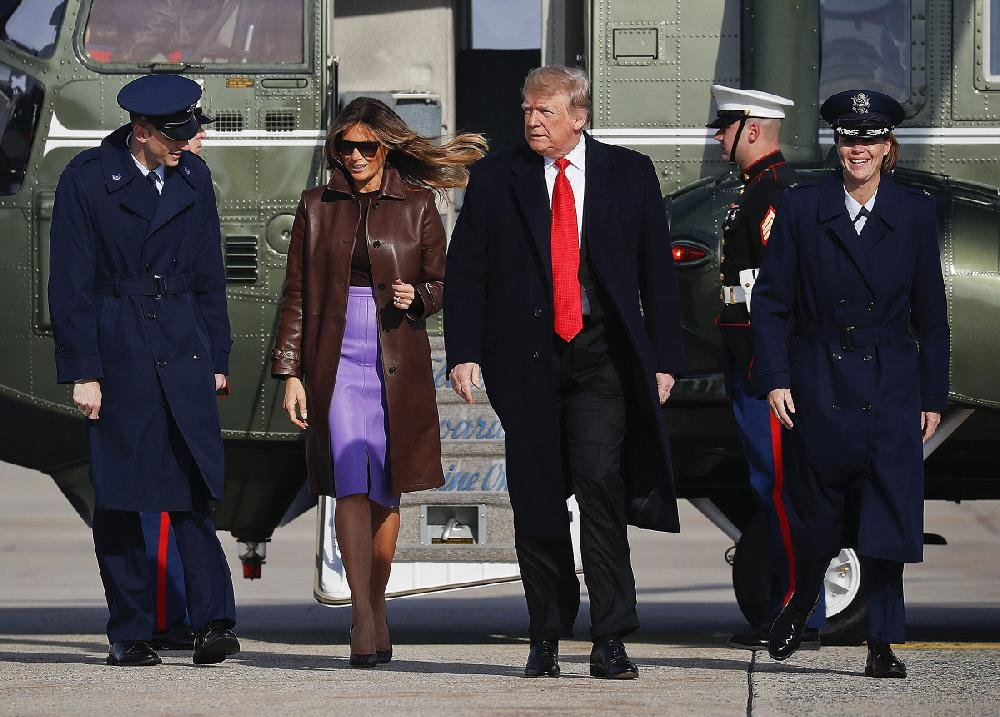 President Donald Trump and first lady Melania Trump head from Marine One to Air Force One at Andrews Air Force Base, Md., on Thursday on their way to the G-20 summit in Buenos Aires, Argentina. Trump called off a planned meeting with Russian President Vladimir Putin at the session but later hinted that they would confer at some point.