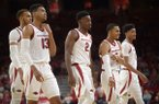 Arkansas players (from left) Daniel Gafford, Mason Jones, Adrio Bailey, Jalen Harris and Isaiah Joe walk toward the bench during a game against Florida International on Saturday, Dec. 1, 2018, in Fayetteville.