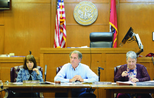 Columbia County Judge Larry Atkinson (middle), speaks Monday during the county's monthly Quorum Court meeting at the Columbia County Courthouse in Magnolia. Also pictured are County Attorney Rebecca Jones (left) and Interim County Clerk Diane Ferguson.