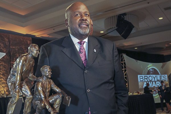 Alabama offensive coordinator Michael Locksley stands with the Broyles Award after he was named the recipient on Tuesday, Dec. 4, 2018, in Little Rock.