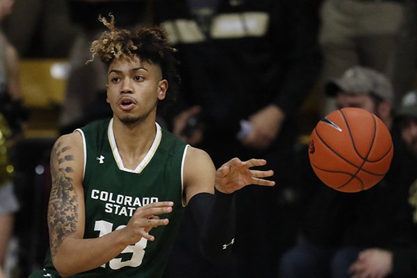 Colorado State Rams guard Lorenzo Jenkins (13) and Colorado Buffaloes guard Deleon Brown (14) in the second half of an NCAA college basketball game Saturday, Dec. 1, 2018, in Boulder, Colo. Colorado won 86-80. (AP Photo/David Zalubowski)