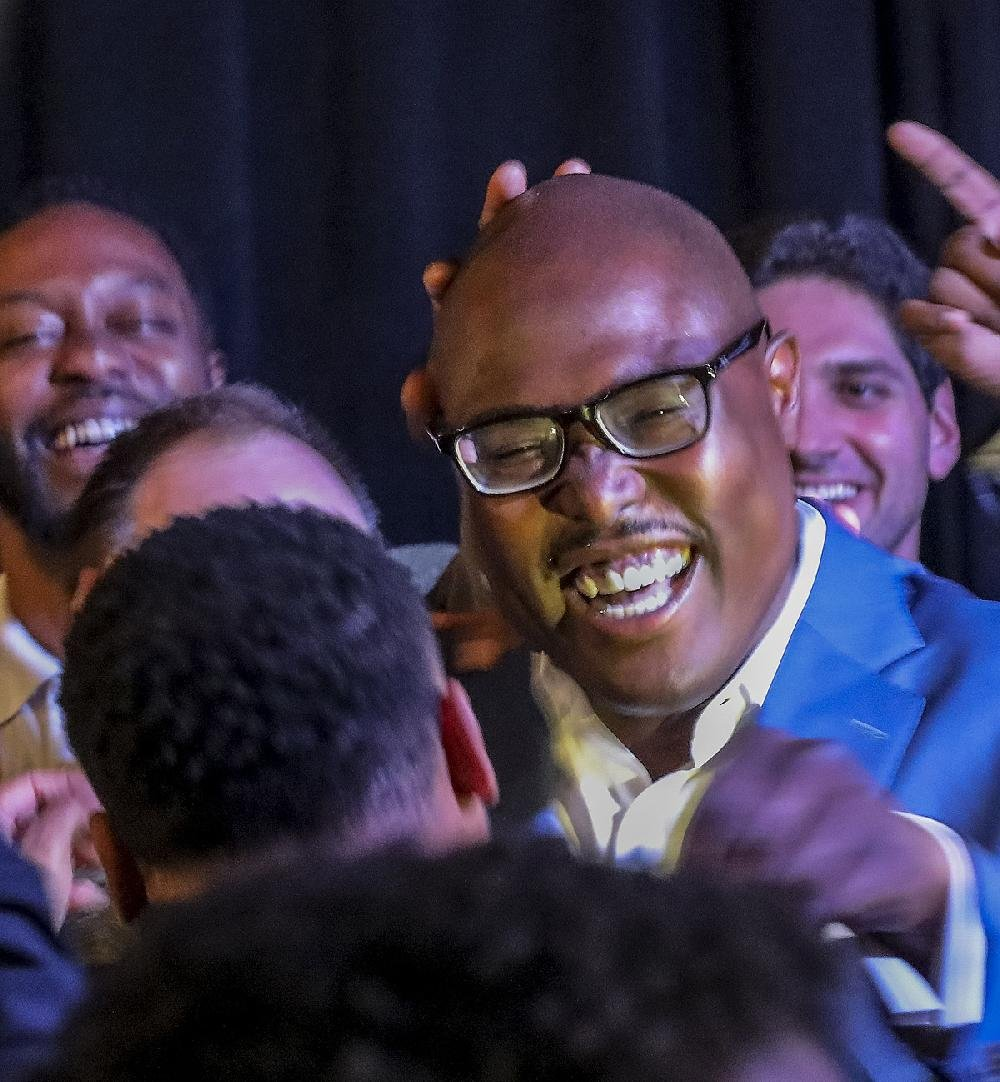 "Frank Scott Jr. hugs family and friends at his watch party Tuesday night at Cajun's Wharf. ""I thank you. For every text message and phone call, I thank you,"" he told supporters. ""And for the voters who did not vote for us, I want to earn your support."""
