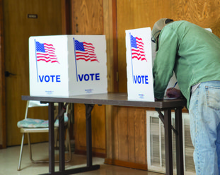 Voters at Taylor City Hall take the polls Tuesday for runoff elections to decide a new mayor in each Columbia County town.