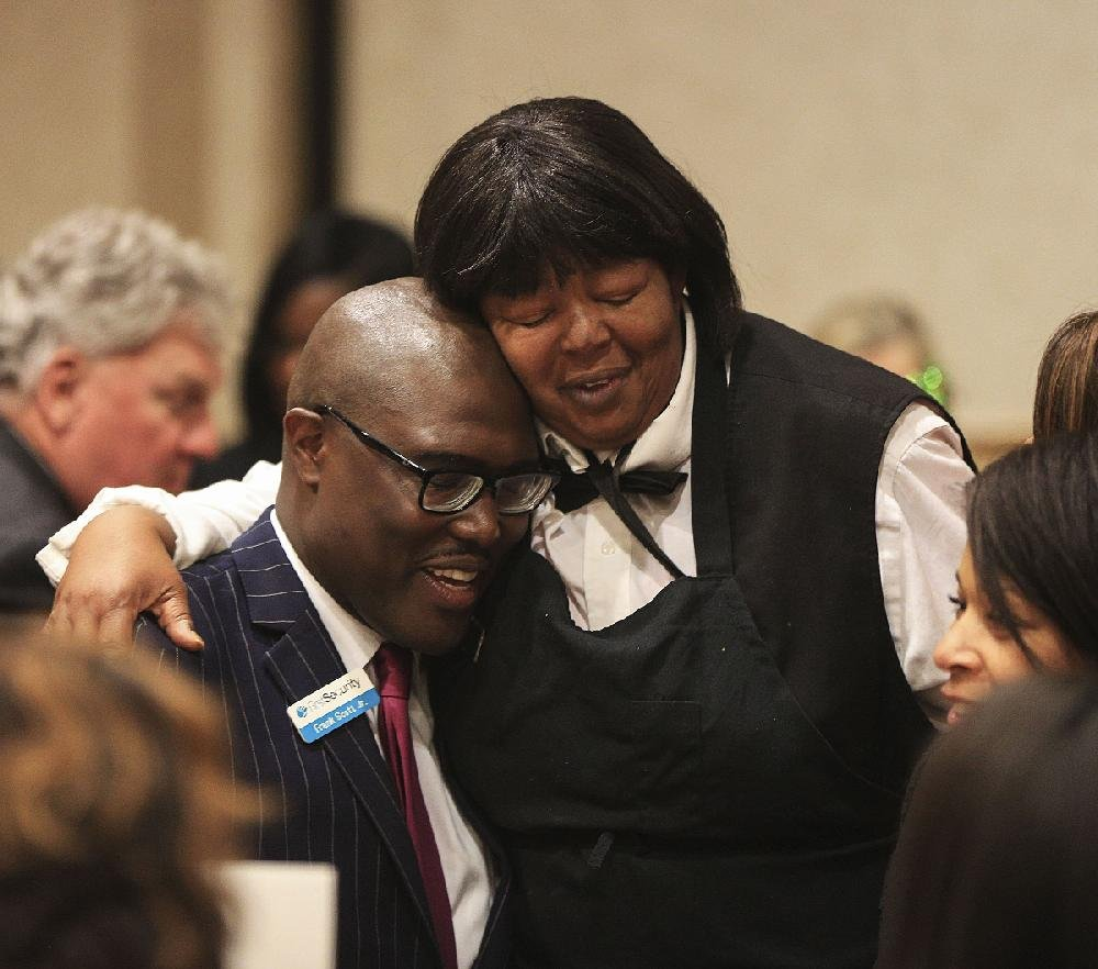 Little Rock Mayor-elect Frank Scott Jr. gets a congratulatory hug Wednesday from Renee Goynes, banquet captain at the Wyndham Riverfront Hotel in North Little Rock, during the Urban League of Arkansas' Whitney M. Young Jr. Awards luncheon.