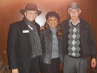 Submitted photo SINGER HONORED: From left are John Rumble, senior historian of the Country Music Hall of Fame and Museum, Petrella and Bob Pollefeyt, Petrella's manager.