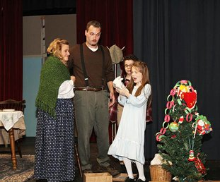 """Submitted Photo CHRISTMAS SURPRISE: Actors from the Pocket Theatre's production of """"Yes, Virginia, there is a Santa Claus"""" act out a scene from the play. The performances conclude this weekend with shows on Friday and Saturday at 7:30 p.m. and a matinee on Sunday at 2:30."""