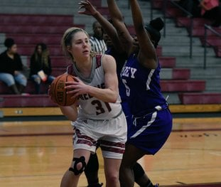 PASS THE ROCK: Henderson State senior forward Brittany Branum (31) looks for a passing option Tuesday during the Reddies' 61-45 win against Wiley College at the Duke Wells Center in Arkadelphia. Photo by Hunter Lively, courtesy of Henderson State Athletic Communications.