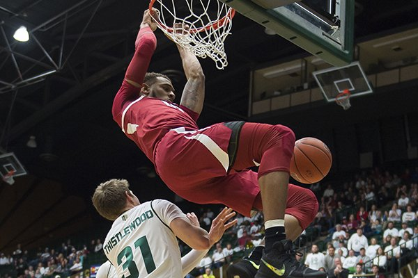 Arkansas' Daniel Gafford (10) dunks over Colorado State's Adam Thistlewood (31) during an NCAA college basketball game, Wednesday, Dec. 5, 2018, in Fort Collins, Colo. (Timothy Hurst/The Coloradoan via AP)