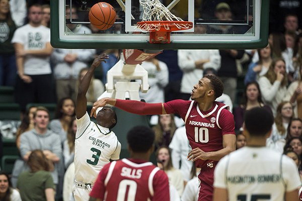 Colorado State guard Kendle Moore (3) makes a shot past Arkansas forward Daniel Gafford (10) during an NCAA college basketball game, Wednesday, Dec. 5, 2018, in Fort Collins, Colo. (Timothy Hurst/The Coloradoan via AP)