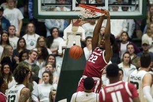 The Associated Press EXCESS RESERVES: Arkansas backup forward Gabe Osabuohien (22) dunks on Colorado State Wednesday during the Razorbacks' 98-74 road win over the Rams at the Moby Arena in Fort Collins, Colo. Timothy Hurst/The Coloradoan.