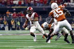 The Associated Press PLAYER OF THE YEAR: Oklahoma Sooners quarterback Kyler Murray (1) looks for room to run against the Texas Longhorns during the first half of the NCAA Big 12 Conference championship Saturday in Arlington, Texas. Murray was named The Associated Press college football Player of the Year Thursday.