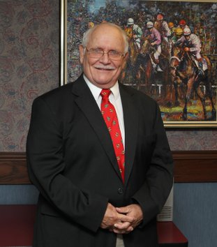 The Sentinel-Record/File photo GOLD STANDARD Gold Standard 2014 honoree Terry Wallace, track announcer at Oaklawn Park for 37 years, passed away Thursday.